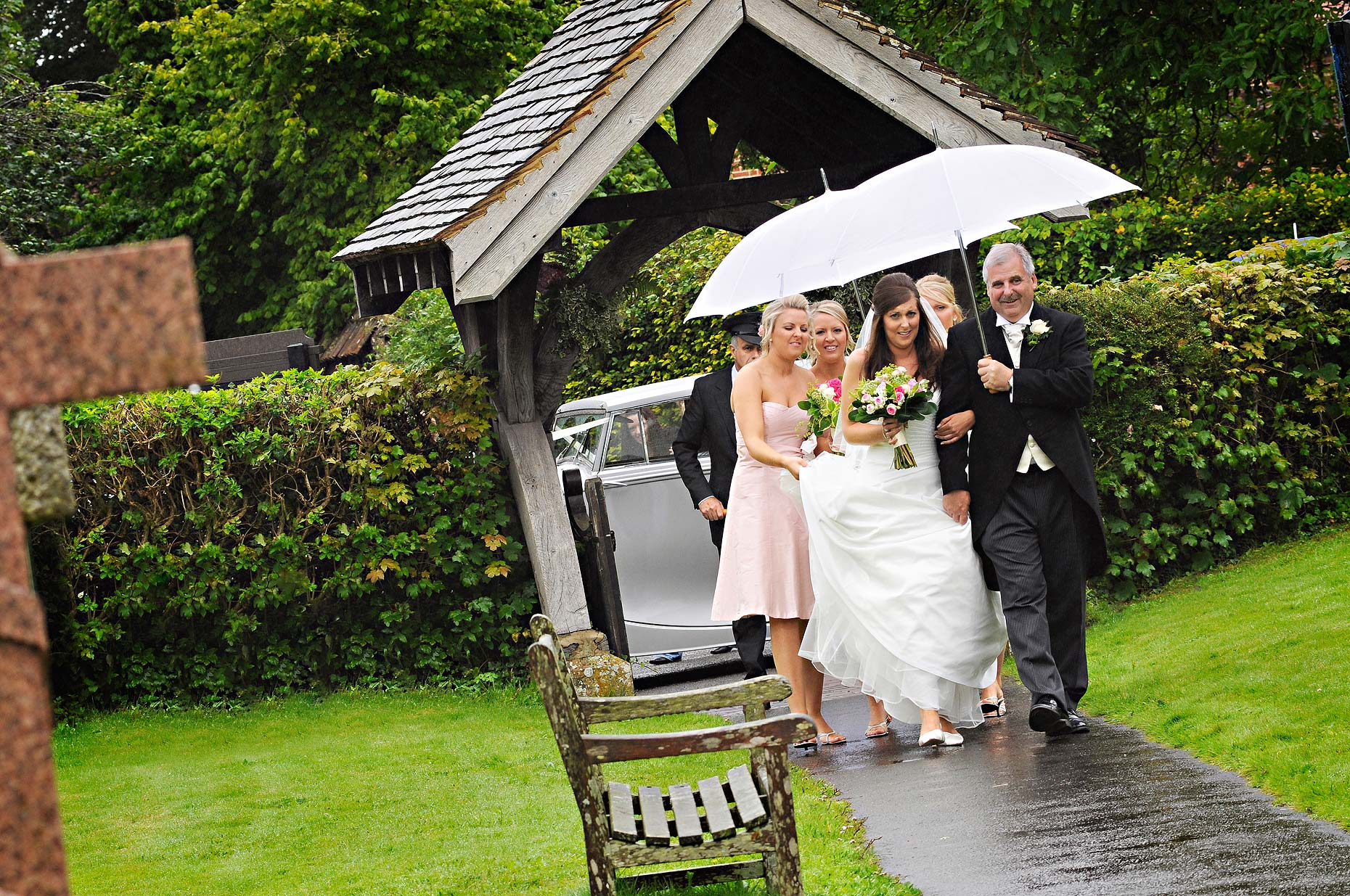 0162-Bride-Arriving-in-the-rain-at-St-James-Church-Ludgershall-Wiltshire-Wedding.jpg