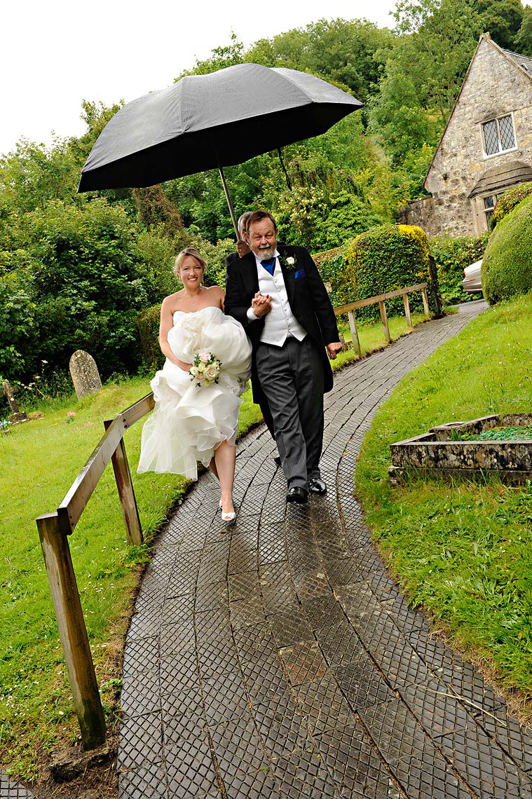 0247-Bride-Arriving-in-the-rain-at-Woolland-Church-Blandford-Dorset.jpg